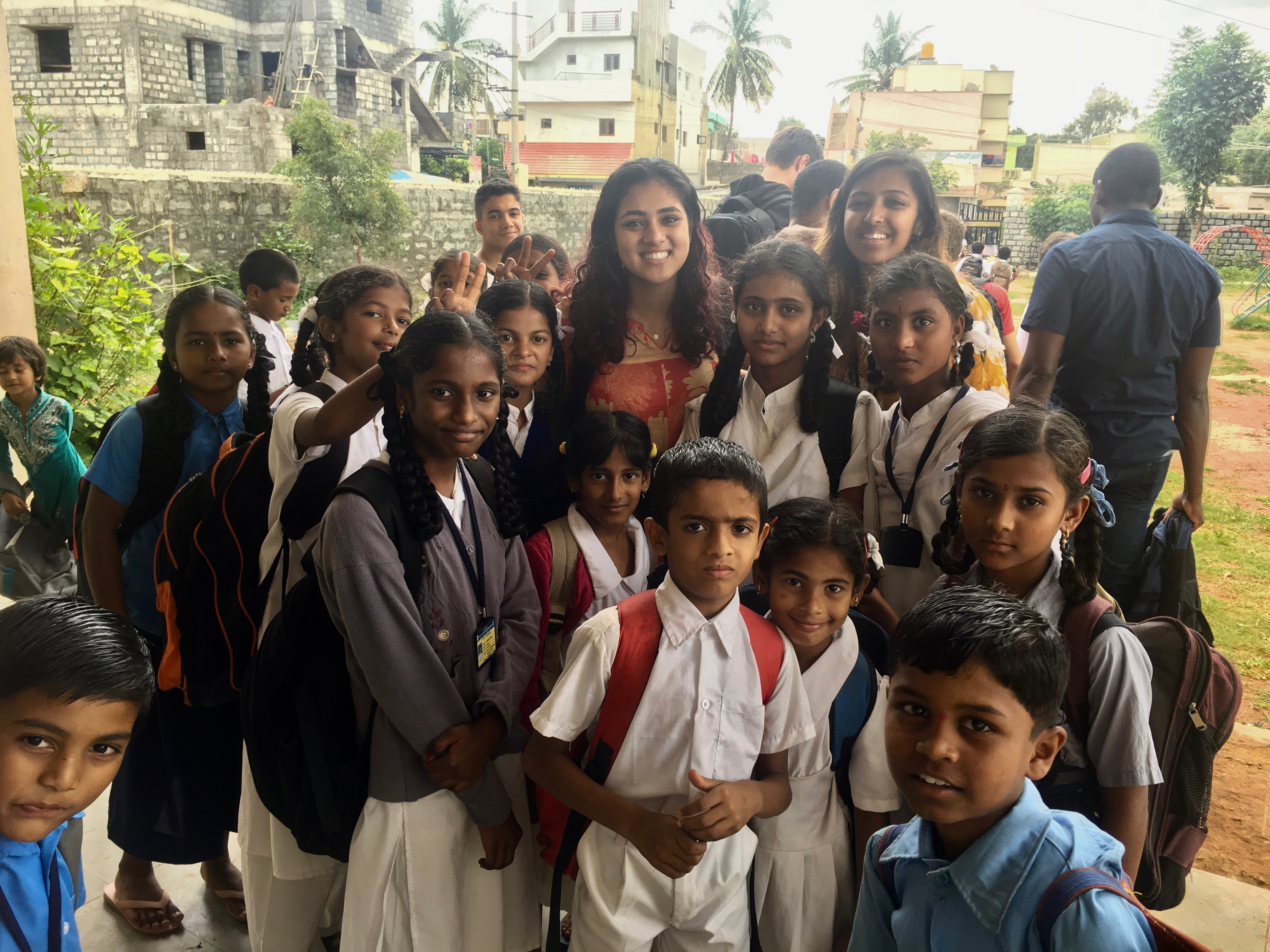 picture of Priya and her friend Nidha with a group of elementary students in Bangalore, India
